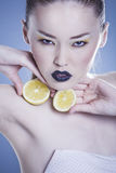 Girl with Lemon Stock Photography