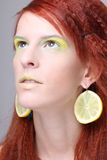 Girl with lemon slices in ears dreaming Royalty Free Stock Photo