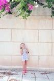 Girl with lemons. Little girl holding lemons and smiling Stock Photo