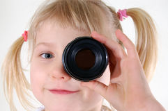 Girl with lens. Little girl with lens Royalty Free Stock Photo
