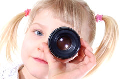 Girl with lens. Little girl with lens Royalty Free Stock Image