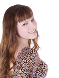 Girl in leopard dress posing over white Royalty Free Stock Image
