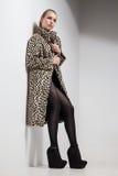 Girl in leopard print coat Stock Photos