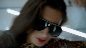 Girl in a leopard print dress and sunglasses dancing in smoke stock footage