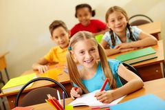 Girl at lesson Stock Images
