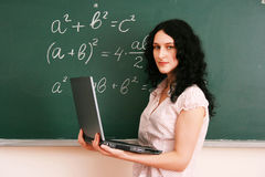 Girl at the lesson with laptop Royalty Free Stock Images