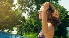 Girl let down her hair. the Action in slow motion stock video footage