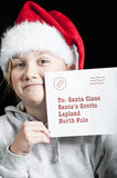 Girl with letter for santa Stock Images
