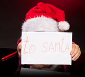 Girl with letter to santa claus Stock Photo