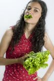 Girl with lettuce Stock Photo