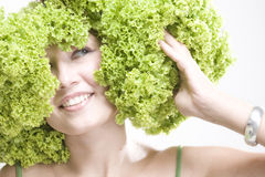Girl with lettuce hairdo Stock Image