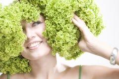 Girl with lettuce hairdo Stock Image