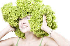 Girl with lettuce hairdo Stock Images