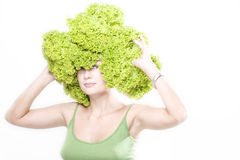 Girl with lettuce hairdo Royalty Free Stock Image