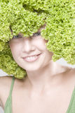 Girl with lettuce hairdo Stock Photography
