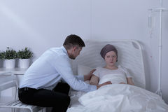 Girl with leukemia. Despair girl with leukemia and supporting dad Royalty Free Stock Photo