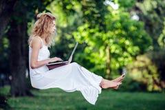 Girl levitates with laptop Stock Photos