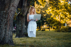 Girl levitates with laptop Royalty Free Stock Image