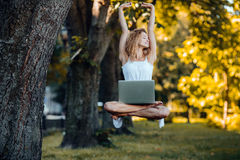 Girl levitates with laptop Stock Photo