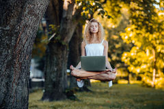 Girl levitates with laptop Stock Image