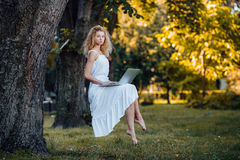Girl levitates with laptop Stock Images