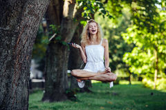 Girl levitates in nature Stock Photography