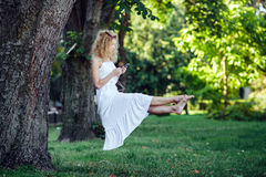 Girl levitates in nature Royalty Free Stock Image