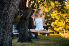 Girl levitates in nature Royalty Free Stock Photo