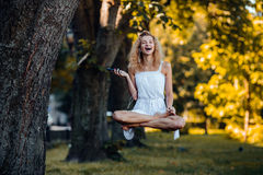 Girl levitates in nature Royalty Free Stock Photos
