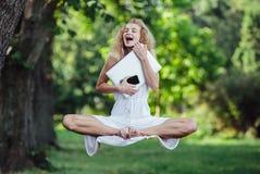 Girl levitates in nature Stock Image