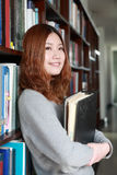 Girl in library Stock Photo