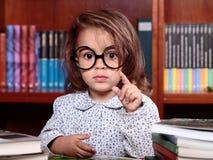 Girl in library Stock Photos