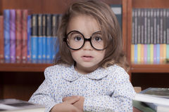 Girl in library stock photography