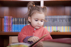 Girl in library royalty free stock image