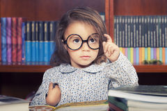 Girl in library royalty free stock photo