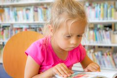 Girl in a Library Royalty Free Stock Photos