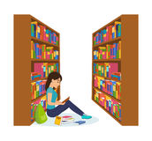 Girl in library, reading book and working with necessary materials. Royalty Free Stock Image