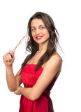 Girl lick white-red candy in the form of heart with beautiful ma Royalty Free Stock Images