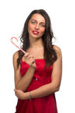 Girl lick white-red candy in the form of heart with beautiful ma Royalty Free Stock Photos