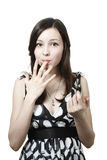 Girl licked her fingers Stock Photos