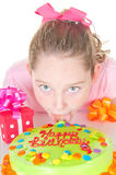 Girl licking cake Stock Photos