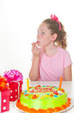 Girl licking candle on birthday Royalty Free Stock Photography