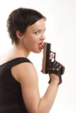 Girl licking her gun. Stylish brunette girl in black clothes licking her gun Stock Photo
