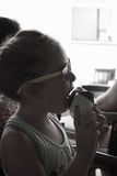 Girl licking ice cream cone,black and white image Royalty Free Stock Image