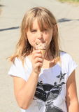 Girl licking ice-cream Stock Photo