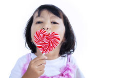 Girl licking lollipop Stock Images