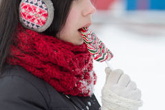 Girl licking lollipop candy Stock Photo