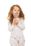 Girl licking a tasty lollipop Stock Photo