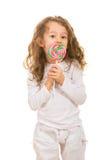 Girl licking a tasty lollipop Stock Photo