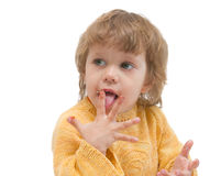 Girl licks fingers Royalty Free Stock Images